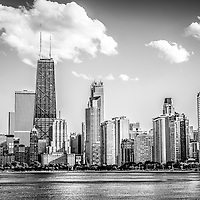 Chicago skyline picture in black and white. Photo includes Hancock building and other popular downtown Chicago city buildings. The John Hancock Center building is one of the world's tallest skyscrapers. Photo is high resolution and was taken in 2012.