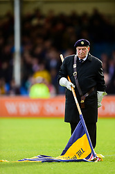 The Flag Bearer lowers the flag during the Remembrance Ceremony prior to kick off - Mandatory by-line: Ryan Hiscott/JMP - 10/11/2018 - RUGBY - Sandy Park Stadium - Exeter, England - Exeter Chiefs v Harlequins - Premiership Rugby Cup
