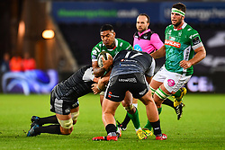 Monty Ioane of Benetton Treviso is tackled by Justin Tipuric and Rhodri Jones of Ospreys<br /> <br /> Photographer Craig Thomas/Replay Images<br /> <br /> Guinness PRO14 Round 4 - Ospreys v Benetton Treviso - Saturday 22nd September 2018 - Liberty Stadium - Swansea<br /> <br /> World Copyright © Replay Images . All rights reserved. info@replayimages.co.uk - http://replayimages.co.uk