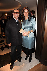 PROF.DAVID KHALILI and his wife MARRION at a dinner hosted by jewellers Damiani at The Connaught Hotel, London on 3rd February 2010.