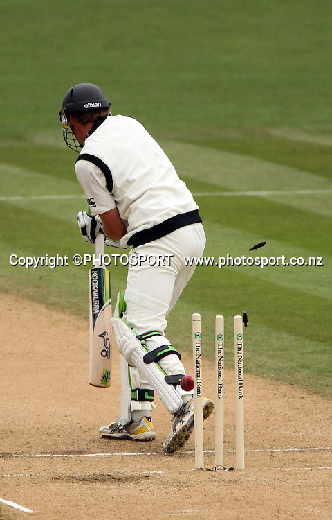Tim McIntosh is bowled for 136 runs by Jerome Taylor during play on day 3 of the second cricket test at McLean Park in Napier. National Bank Test Series, New Zealand v West Indies, Sunday 21 December 2008. Photo: Andrew Cornaga/PHOTOSPORT