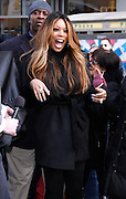 Wendy Williams poses to unveil PETA Campaign poster in Times Square in New York City, New York on November 28, 2012.