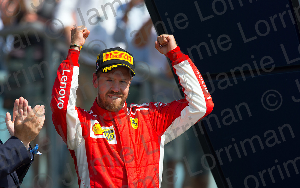 The 2018 Formula 1 F1 Rolex British grand prix, Silverstone, England. Sunday 8th July 2018.<br /> <br /> Pictured: Scuderia Ferrari driver Sebastian Vettel celebrates winning the British Formula 1 Grand Prix at Silverstone.<br /> <br /> Jamie Lorriman<br /> mail@jamielorriman.co.uk<br /> www.jamielorriman.co.uk<br /> 07718 900288