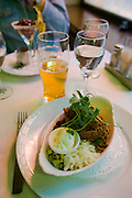"""Vorschmack"", a classic Helsinki entree: shortly roasted lamb and beef meet ground with herring and anchovies; served with onions, pickles, red beet, sour cream and mashed potatos?delicious!"