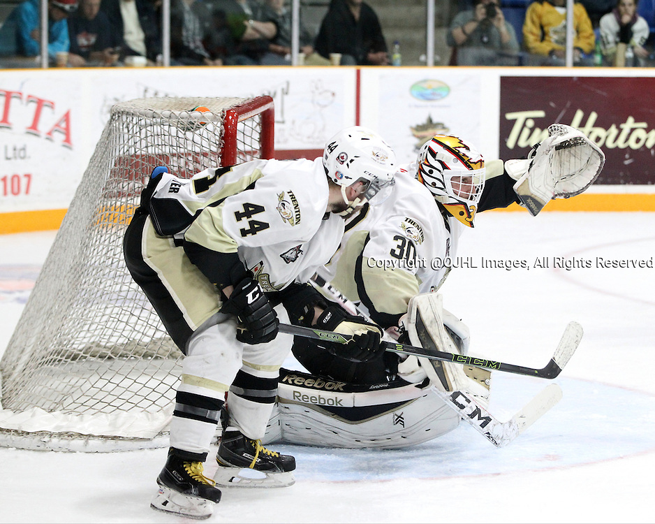 TRENTON, ON - Apr 18, 2016 -  Ontario Junior Hockey League game action between Trenton Golden Hawks and the Georgetown Raiders. Game 3 of the Buckland Cup Championship Series  at the Duncan Memorial Gardens in Trenton, Ontario. Nick Boddy #44 and Daniel Urbani #30 of the Trenton Golden Hawks follows the play during the third period.<br /> (Photo by Tim Bates / OJHL Images)