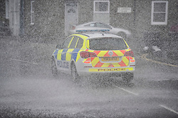 © Licensed to London News Pictures.03/02/2017. A police car is showered in waves battering the coastline at  Penzance in Cornwall as the unofficially named storm DORIS hits the UK coast. Photo credit : Mark Hemsworth/LNP