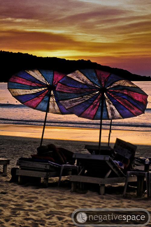 Beach umbrellas at sunset, Patong Beach, Phuket, Thailand