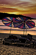 Beach umbrellas at sunset, Patong Beach, Phuket, Thailand