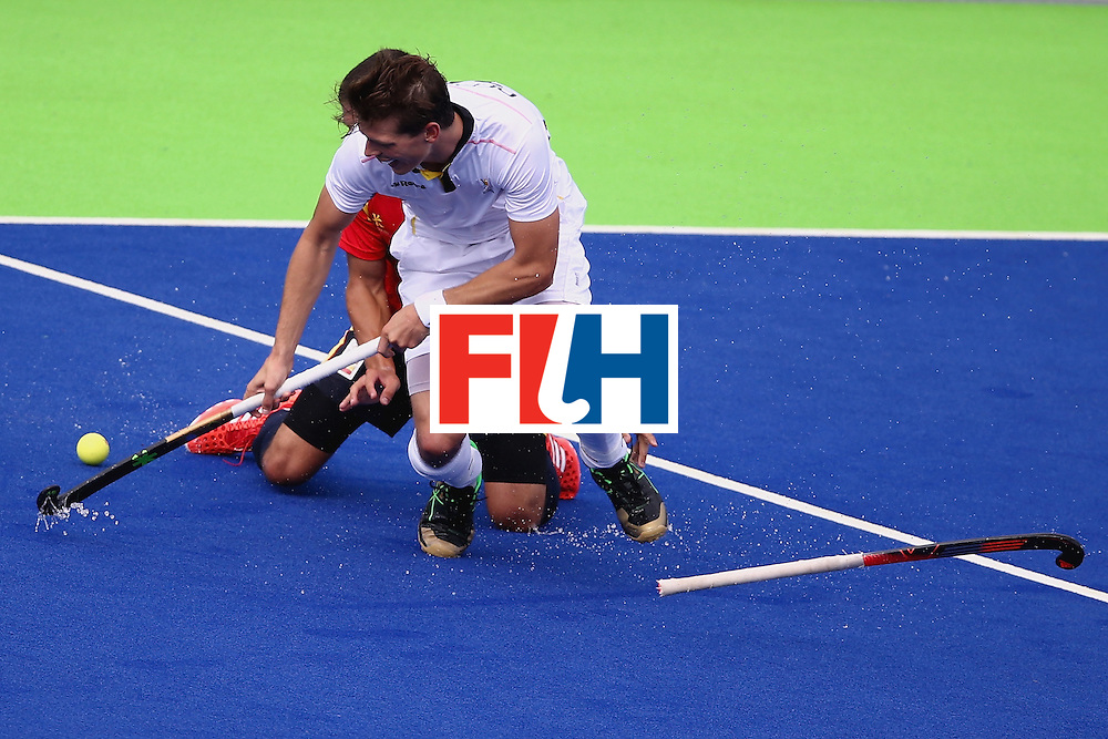 RIO DE JANEIRO, BRAZIL - AUGUST 11:  Salvador Piera #20 of Spain collides with Felix Denayer #19 of Belgium during a Men's Preliminary Pool A match on Day 6 of the Rio 2016 Olympics at the Olympic Hockey Centre on August 11, 2016 in Rio de Janeiro, Brazil.  (Photo by Sean M. Haffey/Getty Images)