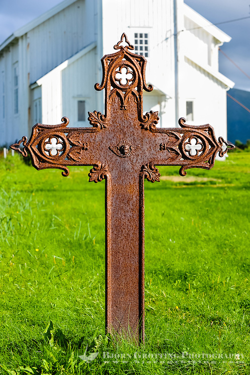 Norway, Lofoten. Gimsøy church is a wooden church from 1876. It is secured with strong wires for wind protection. An old iron cross.