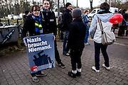 Magdeburg | 18 Jan 2014<br /> <br /> ACHTUNG BESONDERE HONORARKONDITIONEN!<br /> <br /> Am Samstag (19.01.2014) marschierten etwa 1000 Neonazis bei einem &quot;Gedenkmarsch&quot; durch Magdeburg, um der Bombardierungen der Stadt im 2. Weltkrieg zu &quot;gedenken&quot;.<br /> Hier: Anti-Nazi-Demonstranten mit einem Plakat mit der Aufschrift &quot;Nazie braucht niemand&quot; am Bahnhof Magdeburg-Herrenkrug.<br /> <br /> &copy;peter-juelich.com<br /> <br /> [No Model Release | No Property Release]