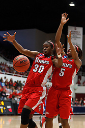 March 19, 2011; Stanford, CA, USA; St. John's Red Storm forward Centhya Hart (30) grabs a rebound against the Texas Tech Lady Raiders during the second half of the first round of the 2011 NCAA women's basketball tournament at Maples Pavilion. St. John's defeated Texas Tech 55-50.