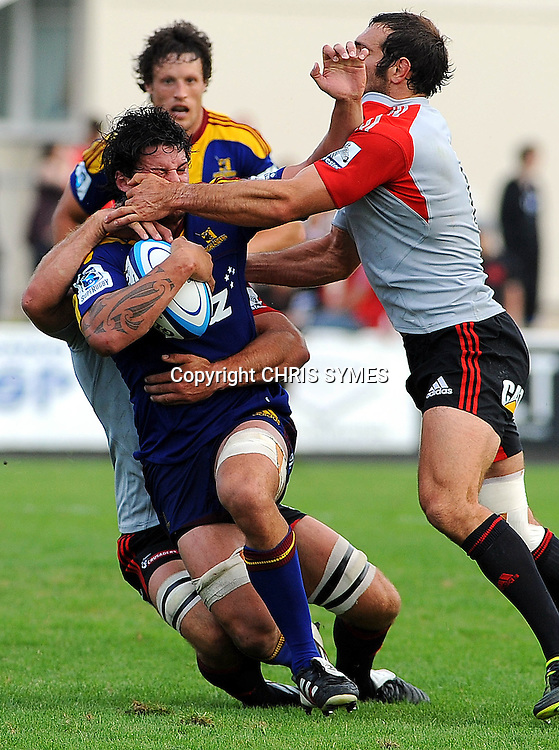 Highlanders Elliot Dixon is tackled Crusader George Whitelaock during their Super Rugby Pre-season game Crusaders v Highlanders. Rugby Park, Greymouth, New Zealand. Friday 3 February 2012. Photo: Chris Symes/www.photosport.co.nz