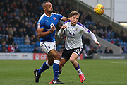 Chesterfield forward Chris O'Grady and Luton Town midfielder Luke Berry challenge for the ball during the EFL Sky Bet League 2 match between Chesterfield and Luton Town at the Proact stadium, Chesterfield, England on 13 January 2018. Photo by Aaron  Lupton.
