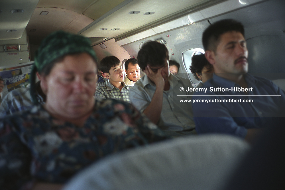 Passengers on a flight from the northen city of Khojand to the capital Dushanbe, Tajikistan.