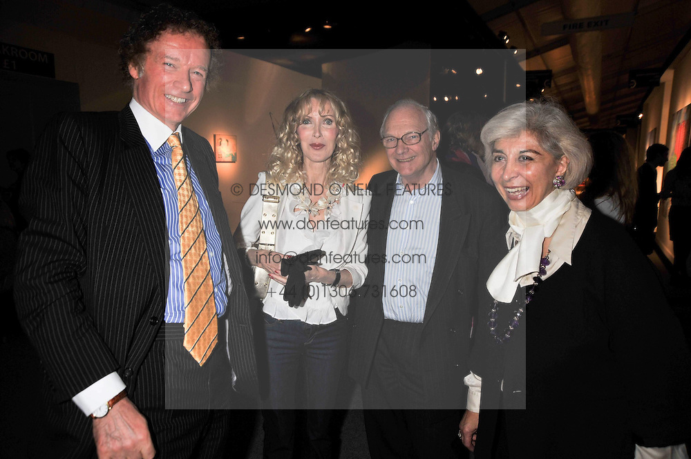 Left to right, RICHARD & BASIA BRIGGS and LORD & LADY RENWICK at the Moet Hennessy Pavilion of Art & Design London Prize 2009 held in Berkeley Square, London on 12th October 2009.