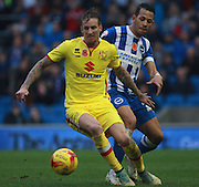 MK Dons midfielder Carl Baker shields the ball from Brighton defender full back Liam Rosenior during the Sky Bet Championship match between Brighton and Hove Albion and Milton Keynes Dons at the American Express Community Stadium, Brighton and Hove, England on 7 November 2015. Photo by Bennett Dean.