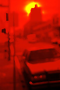abstract shot of San Francisco seen out of focus through a red 25 filter.