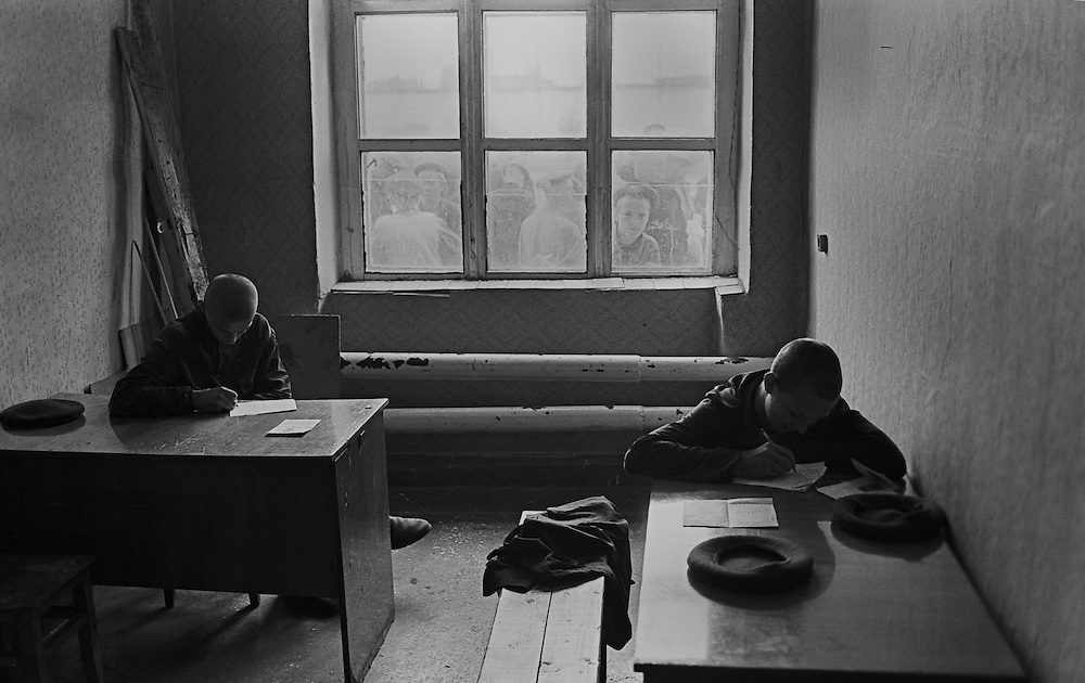 Russian young prisoners write letters in room for rest at the  colony for prisoner's children in Siberian town Leninsk-Kuznetsky, Russia, 27 September 1999.