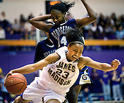 (11/18/09) - (Harrisonburg).James Madison's Dawn Evans drives past Georgetown's Ta'Shauna Rodgers during first-half action at the JMU Convocation Center in Harrisonburg on Wednesday. JMU upset the Hoyas 79-76..(Pete Marovich/Daily News-Record)