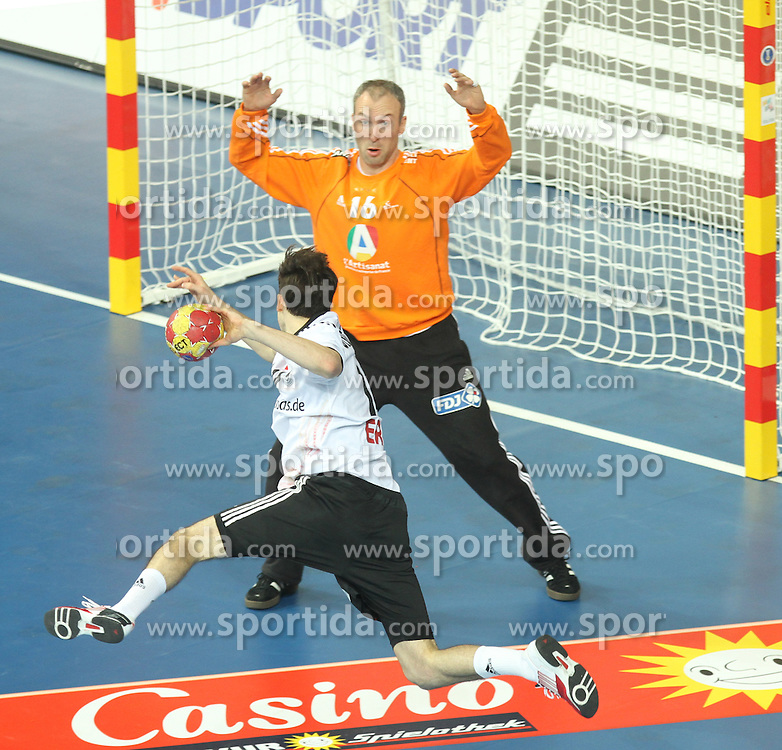18.01.2013 Barcelona, Spain. IHF men's world championship, prelimanary round. Picture show Patrick Groetzki  and Thierry Omeyer   in action during game between France vs Germany at Palau St Jordi / Sportida Photo Agency