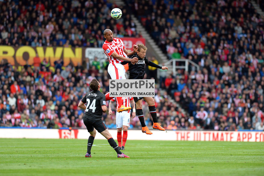 Lucas of Liverpool jumps with Steven N`Zonzi