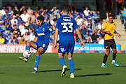 AFC Wimbledon defender Will Nightingale (5) passing ball to AFC Wimbledon midfielder Callum Reilly (33) during the EFL Sky Bet League 1 match between AFC Wimbledon and Bristol Rovers at the Cherry Red Records Stadium, Kingston, England on 21 September 2019.