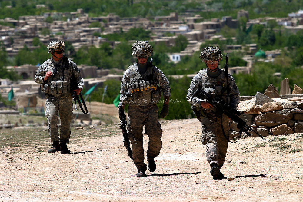Soldiers of the 3rd platoon of the 10th mountain division talk to locals during a patrol in Logar province, Afghanistan on Tuesday, May 12th 2009...Photo: Guilad Kahn.