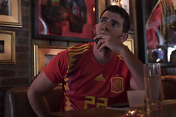 July 1, 2018 - Miami Beach, FL, USA - Marcel Shorago, 25, watches a soccer match at Tapas and Tintos, a restaurant in Miami Beach, Fla. where fans gathered to watch Spain take on Russia during the 2018 FIFA World Cup Round of 16 knockout stage on Sunday, July 1, 2018. After the score being tied 1-1 at the end of extra time, Russia won, 4 penalty kicks to 3. (Credit Image: © Ellis Rua/TNS via ZUMA Wire)