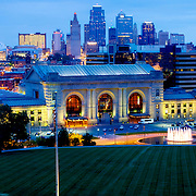 Kansas City Missouri skyline at dusk with Union Station in foreground.