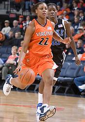 Virginia Cavaliers Guard Monica Wright (22) dribbles past Duke Blue Devils Forward Bridgette Mitchell (15).  The University of Virginia Cavaliers lost to the #1 ranked Duke University Blue Devils 76-61 at the John Paul Jones Arena in Charlottesville, VA on February 2, 2007.