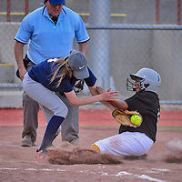 Madison Hyatt attempts to tag out Madison Belone as she slides into home base during the Tiger-Pirate softball game on Wednesday at Ford Canyon Park in Gallup.