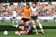 Wolverhampton Wanderers goalkeeper John Ruddy (21) claims the ball ahead of Wolverhampton Wanderers midfielder Conor Coady (16) and Barnsley striker Tom Bradshaw (9) 0-0 during the EFL Sky Bet Championship match between Wolverhampton Wanderers and Barnsley at Molineux, Wolverhampton, England on 23 September 2017. Photo by Alan Franklin.