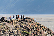 Visitors watch the Bore Tide from Beluga Point along the Turnagain Arm outside Anchorage, Alaska.