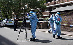 © Licensed to London News Pictures. 12/07/2020. London, UK. Police forensics examine the scene of a murder on the Black Prince Estate in Kennington South London in which a man, believed to be in his 30s, was stabbed to death late last night . Photo credit: Ben Cawthra/LNP