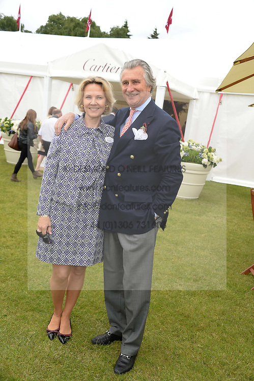 ARNAUD BAMBERGER and his wife CARLA BAMBERGER at the 2013 Cartier Queens Cup Polo at Guards Polo Club, Berkshire on 16th June 2013.