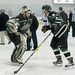 KINGSTON, ON - MAR 9,  2017: Ontario Junior Hockey League, playoff game between the Cobourg Cougars and Kingston Voyageurs, Stefano Durante #29 of the Cobourg Cougars &amp; Reade MacInnis #2 of the Cobourg Cougars celebrate the victory.<br /> (Photo by Ian Dixon/ OJHL Images)