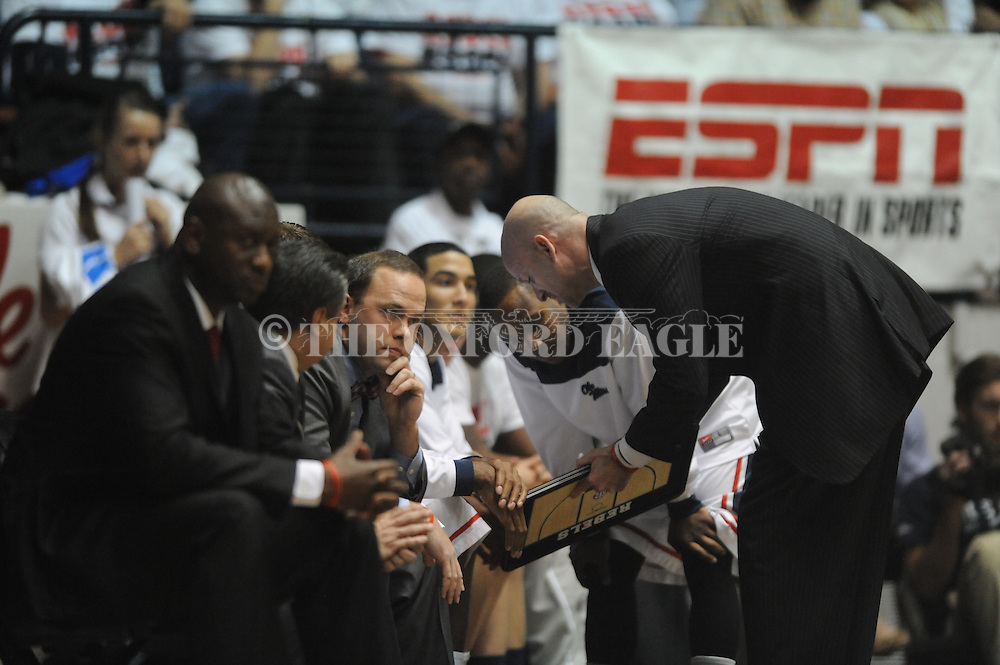"Ole Miss head coach Andy Kennedy talks with coaches and Ole Miss' Derrick Millinghaus (3) vs. Kentucky at the C.M. ""Tad"" Smith Coliseum on Tuesday, January 29, 2013."