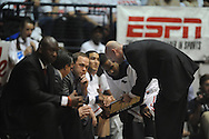 """Ole Miss head coach Andy Kennedy talks with coaches and Ole Miss' Derrick Millinghaus (3) vs. Kentucky at the C.M. """"Tad"""" Smith Coliseum on Tuesday, January 29, 2013."""