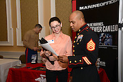 Ohio University student Laura Thomas meets with SSgt Justin Westmoreland at the Career Fair held on February 18, 2014.