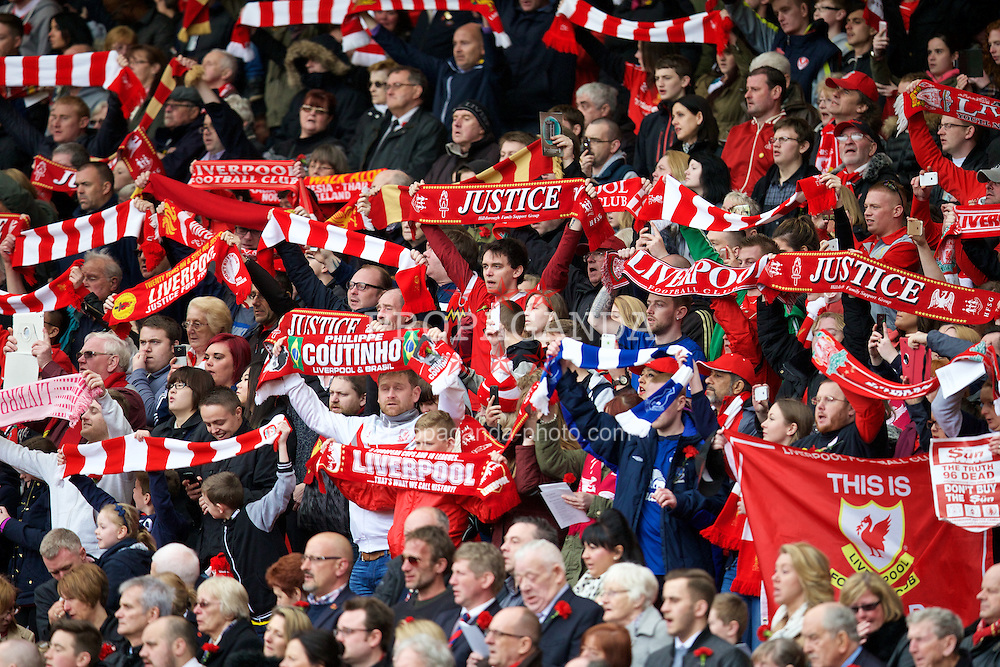 LIVERPOOL, ENGLAND - Wednesday, April 15, 2015: Liverpool supporters stand to sing You'll Never Walk Alone during the 26th Anniversary Hillsborough Service at Anfield. (Pic by David Rawcliffe/Propaganda)
