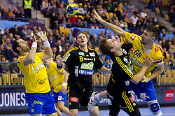 Alem Toskic of Celje and Mate Lekai of Celje vs Jesper Nielsen and  E. Forsell of Savehof during handball match between RK Celje Pivovarna Lasko and IK Savehof (SWE) in 3rd Round of Group B of EHF Champions League 2012/13 on October 13, 2012 in Arena Zlatorog, Celje, Slovenia. (Photo By Vid Ponikvar / Sportida)