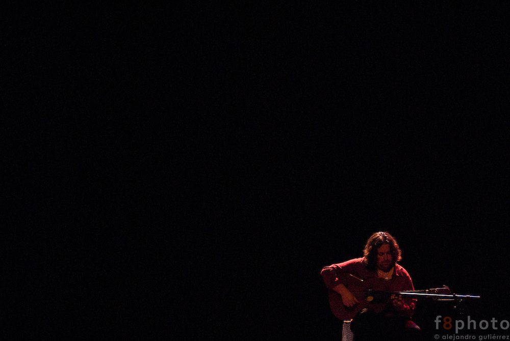 "The guitarrist Josue Luis rodríguez during the guitar concert ""Tocando al Sentimiento"" in the Second International Dance Festival Ibérica Contemporánea, Querétaro, México, 2009"