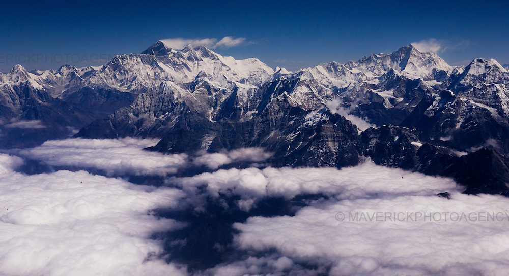 View of the Himalayan mountain range showing Mt Everest (highest peak middle left)  from a plane in Nepal.