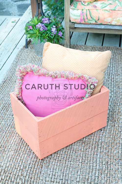 Painted crate filled with outdoor pillows