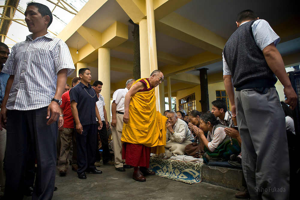 Dalai Lama gives blessings to Tibetan buddhists as he makes his way out of the temple after a morning prayer ceremony in Dharamsala, India, May 26, 2009.