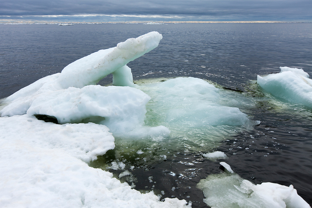 Canada, Manitoba, Churchill, Melting sea ice on Hudson Bay on overcast summer morning