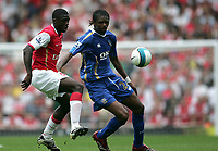 Photo: Lee Earle.<br /> Arsenal v Portsmouth. The FA Barclays Premiership. 02/09/2007.Arsenal's Kolo Toure (L) battles with Kanu.