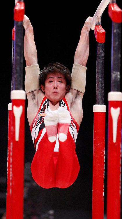 2015 Artistic Gymnastics World Championships being held in Glasgow from 23rd October to 1st November 2015....Japan's Ryohei Kato performs in the Parallel Bars competition in the Men's Team Final...(c) STEPHEN LAWSON | SportPix.org.uk