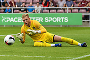 Northampton Town goalkeeper David Cornell (1) makes an important save during the Pre-Season Friendly match between Northampton Town and Sheffield United at the PTS Academy Stadium, Northampton, England on 20 July 2019.
